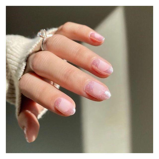 "<p>Amp up a subtle sheer pink with tons of shimmer. These wavy designs keep these nails interesting. </p><p><a class=""link rapid-noclick-resp"" href=""https://go.redirectingat.com?id=74968X1596630&url=https%3A%2F%2Fdearsundays.com%2Fproduct%2Fnail-polish%2Fcolors%2Fno-04%2F&sref=https%3A%2F%2Fwww.goodhousekeeping.com%2Fbeauty%2Fnails%2Fg3186%2Fspring-nail-designs%2F"" rel=""nofollow noopener"" target=""_blank"" data-ylk=""slk:SHOP LIGHT PINK POLISH"">SHOP LIGHT PINK POLISH</a></p><p><a href=""https://www.instagram.com/p/CH23COeH1y8/&hidecaption=true"" rel=""nofollow noopener"" target=""_blank"" data-ylk=""slk:See the original post on Instagram"" class=""link rapid-noclick-resp"">See the original post on Instagram</a></p>"