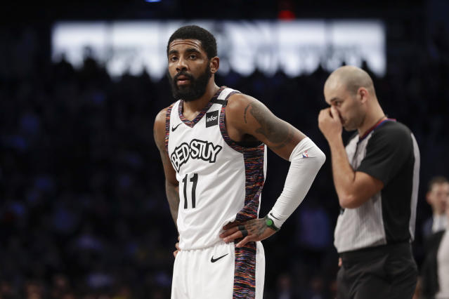 Brooklyn Nets' Kyrie Irving (11) reacts during the first half of an NBA basketball game against the Los Angeles Lakers Thursday, Jan. 23, 2020, in New York. (AP Photo/Frank Franklin II)