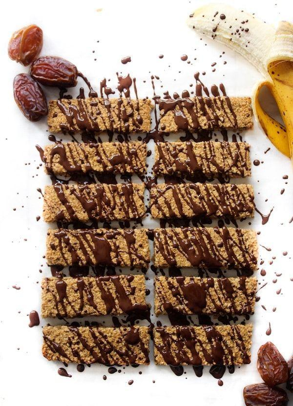 """<p>These gluten-free granola bars are the perfect grab-and-go snack, with or without the chocolate drizzle. </p><p><a class=""""link rapid-noclick-resp"""" href=""""https://www.asaucykitchen.com/banana-and-date-granola-bars/"""" rel=""""nofollow noopener"""" target=""""_blank"""" data-ylk=""""slk:GET THE RECIPE"""">GET THE RECIPE</a></p><p><em>Per serving: 161 calories, 4 g fat, 53 mg sodium, 23 g carbs, 2 g fiber, 8 g sugar, 2 g protein</em><br></p>"""