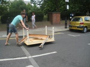 Pushing the furniture into the carpark