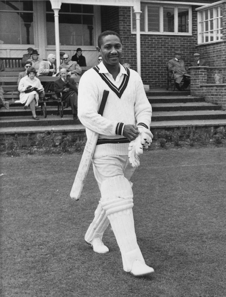 25th April 1963:  West Indian batsman, Frank Worrell (1924 - 1967) pulling on his gloves as he walks out to the crease.  (Photo by Evening Standard/Getty Images)