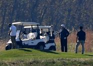 US President Donald Trump (2nd R) golfs at Trump National Golf Club on November 7, 2020 in Sterling, Virginia. - Democrat Joe Biden has won the White House, US media said November 7, defeating Donald Trump and ending a presidency that convulsed American politics, shocked the world and left the United States more divided than at any time in decades. (Photo by Olivier DOULIERY / AFP) (Photo by OLIVIER DOULIERY/AFP via Getty Images)