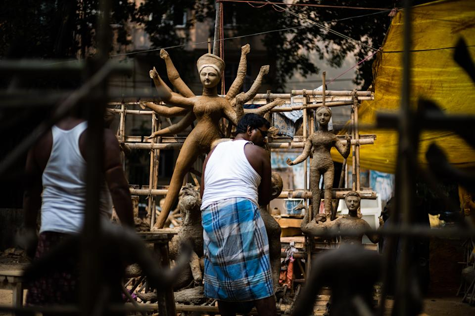 An artisan makes an idol of Hindu goddess Durga in a workshop ahead of the 'Durga Puja' festival in New Delhi on October 14, 2020. (Photo by Jewel SAMAD / AFP) (Photo by JEWEL SAMAD/AFP via Getty Images)