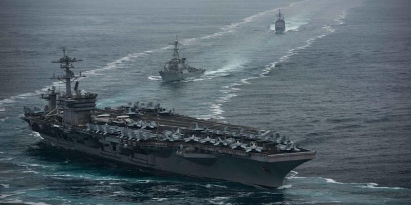 The aircraft carrier USS Theodore Roosevelt (CVN 71), front, the Arleigh Burke-class guided-missile destroyer USS Russell (DDG 59), center, and the Ticonderoga-class guided-missile cruiser USS Bunker Hill (CG 52) transit in formation.