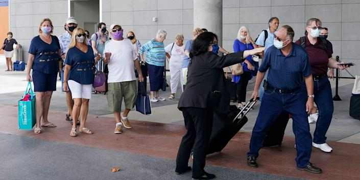 Passengers arrive ahead of the Celebrity Edge's departure on June 26 in Fort Lauderdale, Florida.