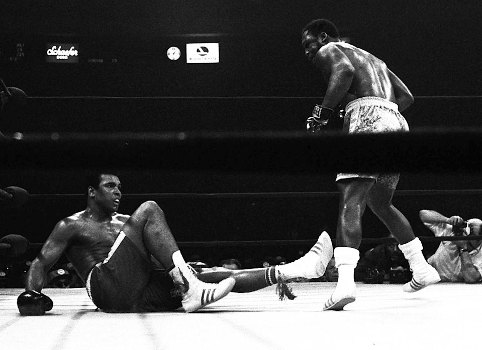 """<p>Joe Frazier knocks down Muhammad Ali in the 15th round of the """"Fight of the Century."""" (AP Photo)</p>"""