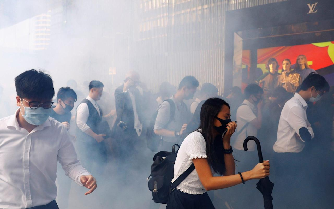 Hong Kong police shoot protester as pro-democracy unrest spirals into rare working-hours violence