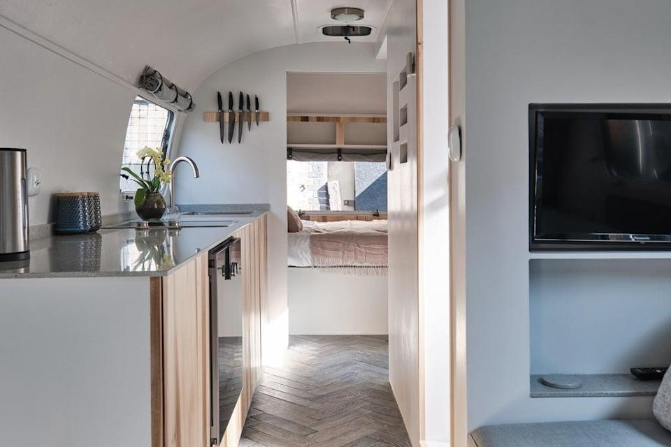 The Overlander has a bedroom with a double bed and, in the main living space, a hydraulic dining table can be lowered to create a second  (Aucoot)
