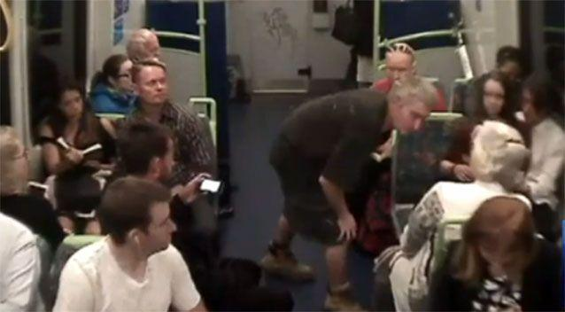 Mr Smart approached a woman on the train, leaning into her face. Photo: 7 News