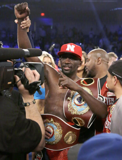Terence Crawford poses for a camera after he won the vacant WBO world junior welterweight boxing title against Thomas Dulorme, Saturday, April 18, 2015, in Arlington, Texas. (AP Photo/LM Otero)