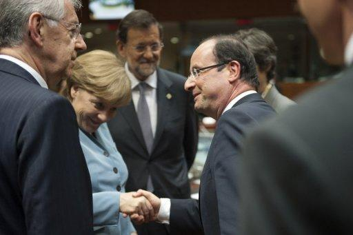 "Hollande said he wanted eurobonds ""written into the agenda,"" though Merkel disagreed"