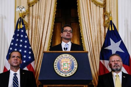 Pedro Pierluisi holds a news conference after swearing in as Governor of Puerto Rico in San Juan, Puerto Rico