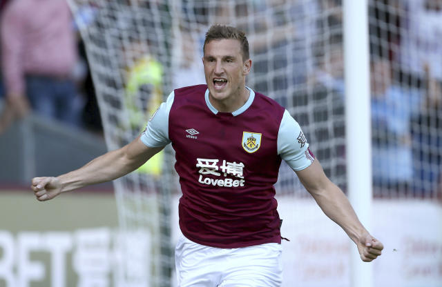 Burnley's Chris Wood celebrates scoring his side's first goal of the game during the English Premier League soccer match between Burnley and Norwich City at the Turf Moor Stadium, Burnley,England. Saturday, Sept. 21 2019. (Richard Sellers/PA via AP)