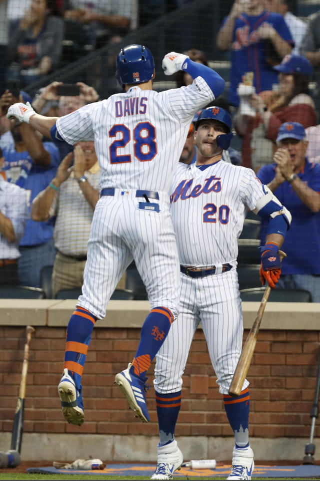 New York Mets on-deck batter Pete Alonso (20) celebrates with teammate J.D. Davis (28) after Davis hit a solo home run off Chicago Cubs starting pitcher Jon Lester during the first inning of a baseball game Thursday, Aug. 29, 2019, in New York. (AP Photo/Kathy Willens)