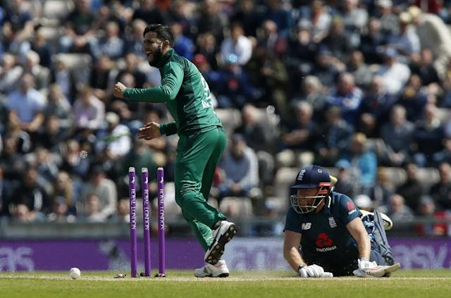Appealing: Pakistan's Imad Wasim tries to run out England's Jonny Bairstow (R) during the 2nd ODI in Southampton (AFP Photo/Ian KINGTON)