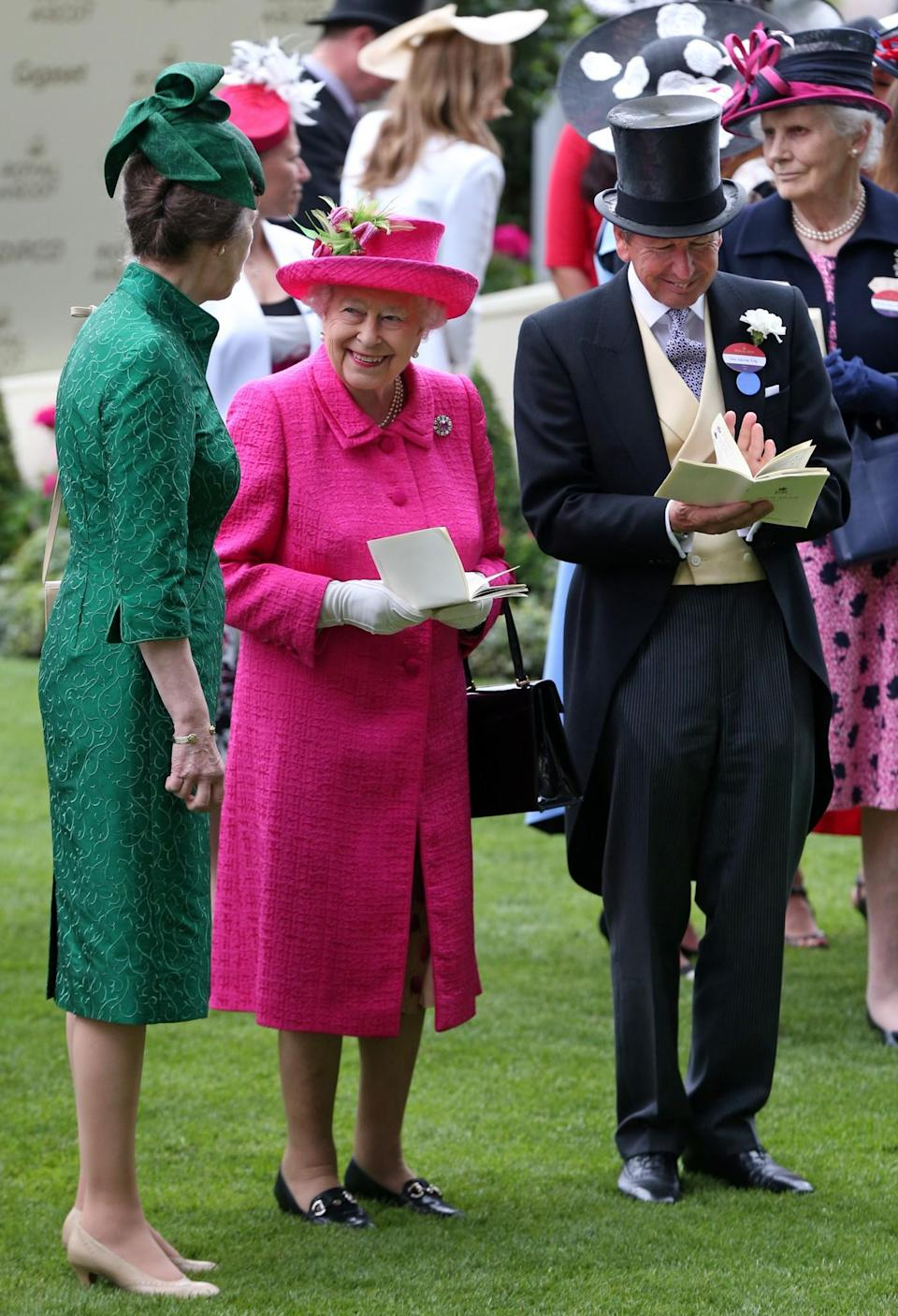 <p>Both the Queen and Princess Anne returned to Royal Ascot again on day three, this time wearing fuschia pink and emerald green, respectively. <br><em>[Photo: PA]</em> </p>