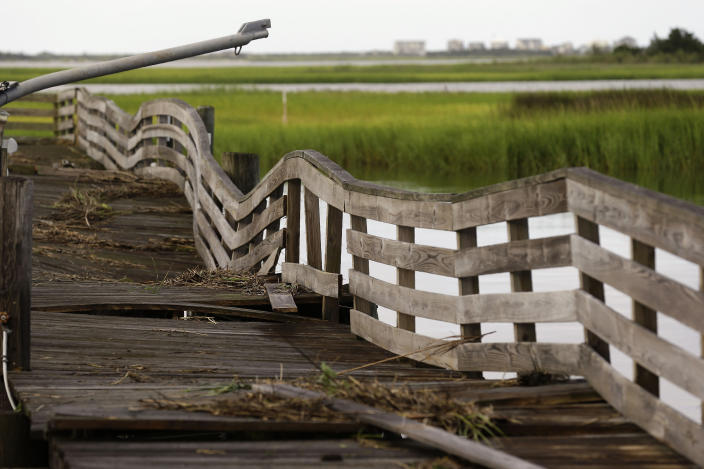 A pier shows damages following the effects of Hurricane Isaias in Southport, N.C., Tuesday, Aug. 4, 2020. (AP Photo/Gerry Broome)