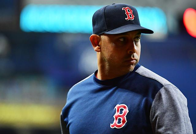 Alex Cora, who led the World Series-winning 2018 Red Sox, was fired in January over his role in the Houston Astros sign-stealing scandal. (Photo by Julio Aguilar/Getty Images)