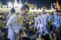 King Maha Vajiralongkorn greets supporters in Bangkok, Thailand, Sunday, Nov. 1, 2020. Under increasing pressure from protesters demanding reforms to the monarchy, Thailand's king and queen met Sunday with thousands of adoring supporters in Bangkok, mixing with citizens in the street after attending a religious ceremony inside the Grand Palace. (AP Photo/Wason Wanichakorn)