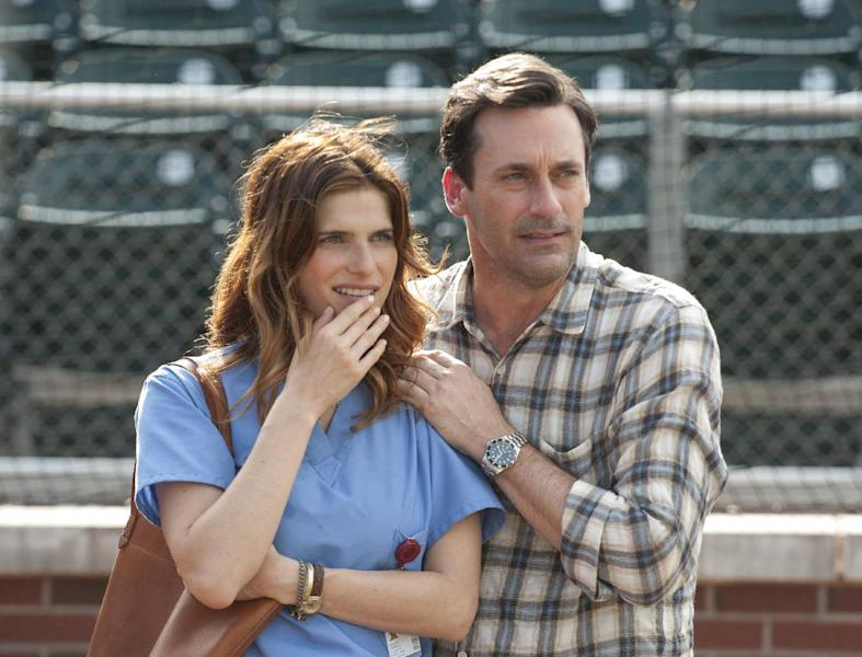 """This image released by Disney shows Lake Bell, left, and Jon Hamm in a scene from the film, """"Million Dollar Arm."""" (AP Photo/Disney, Ron Phillips)"""