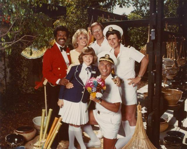 <em>The Love Boat</em> cast (clockwise from top left): Ted Lange, Lauren Tewes, Bernie Kopell, Fred Grandy, Gavin MacLeod, and Jill Whelan, circa 1978. (Photo: Everett Collection)