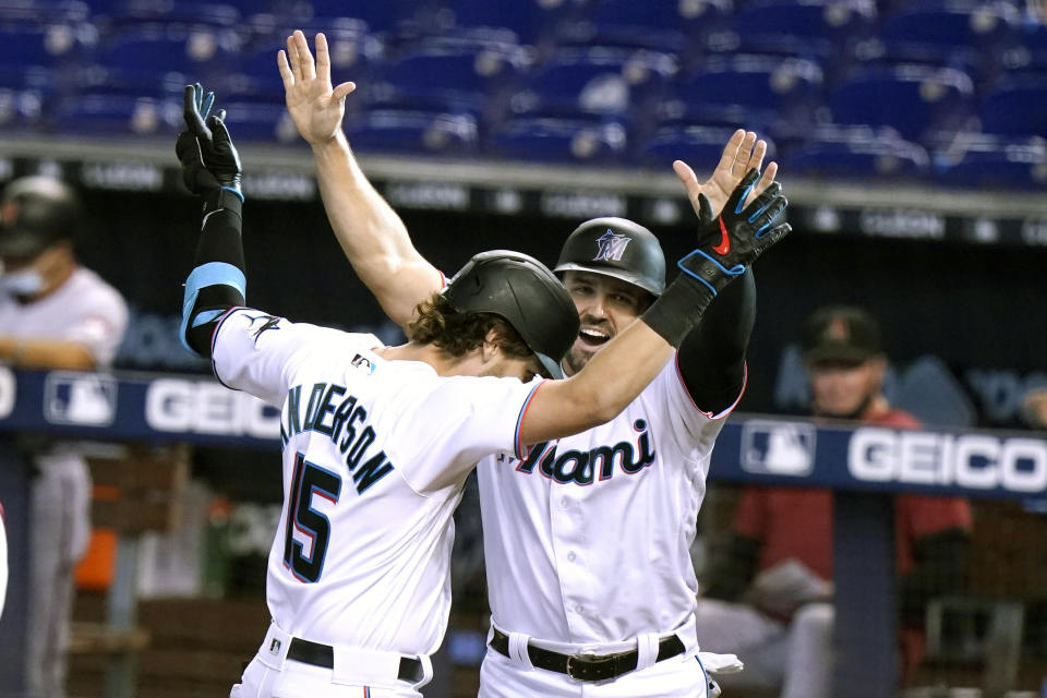 Miami Marlins' Brian Anderson (15) celebrates with Adam Duvall after hitting a three-run home run during the first inning of a baseball game against the Arizona Diamondbacks, Tuesday, May 4, 2021, in Miami. (AP Photo/Lynne Sladky)