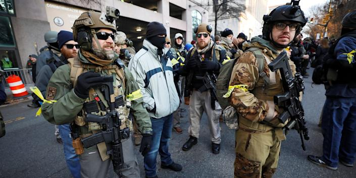 Armed militia members stand guard outside a no-gun zone at a rally by gun rights advocates and militia members near Virginia's Capitol, in Richmond, Virginia