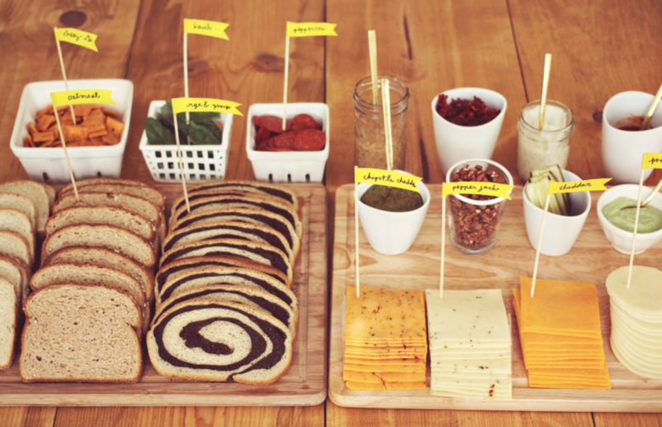 "<p>Did you know that fancy grilled cheeses are now a thing? Instead of ordering catering, set up your own swanky sandwich bar. Your guests will love it.</p><p><strong>See more on <a href=""https://abeautifulmess.com/fancy-grilled-cheese-party/"" rel=""nofollow noopener"" target=""_blank"" data-ylk=""slk:A Beautiful Mess"" class=""link rapid-noclick-resp"">A Beautiful Mess</a>. </strong></p><p><strong><a class=""link rapid-noclick-resp"" href=""https://go.redirectingat.com?id=74968X1596630&url=https%3A%2F%2Fwww.walmart.com%2Fip%2FLarge-Bamboo-Cheese-Board-Charcuterie-Board-Cheese-Fruits-Meat-and-Cracker-Serving-Tray-by-Royal-Craft-Wood%2F131545153&sref=https%3A%2F%2Fwww.thepioneerwoman.com%2Fhome-lifestyle%2Fentertaining%2Fg34192298%2F50th-birthday-party-ideas%2F"" rel=""nofollow noopener"" target=""_blank"" data-ylk=""slk:SHOP CHEESE BOARDS"">SHOP CHEESE BOARDS</a><br></strong></p>"
