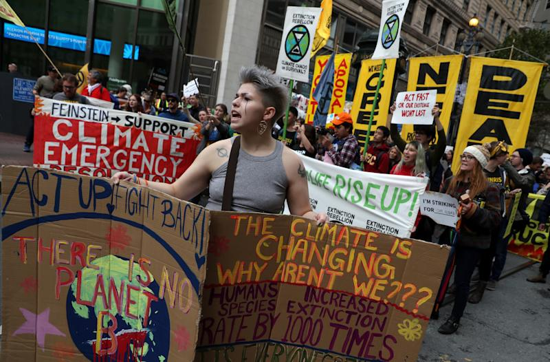 SAN FRANCISCO, CALIFORNIA- DECEMBER 06: Protesters march along Market Street during a youth climate strike on December 06, 2019 in San Francisco, California. Hundreds of youth climate activists staged a demonstration outside of the BlackRock offices in San Francisco as part of a nationwide youth climate strike to coincide with the United Nations climate summit being held in Madrid, Spain (Photo by Justin Sullivan/Getty Images)