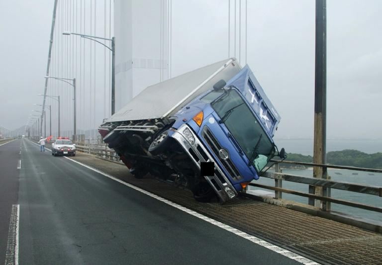 A truck is toppled by typhoon winds on the Seto Ohashi bridge in Sakade