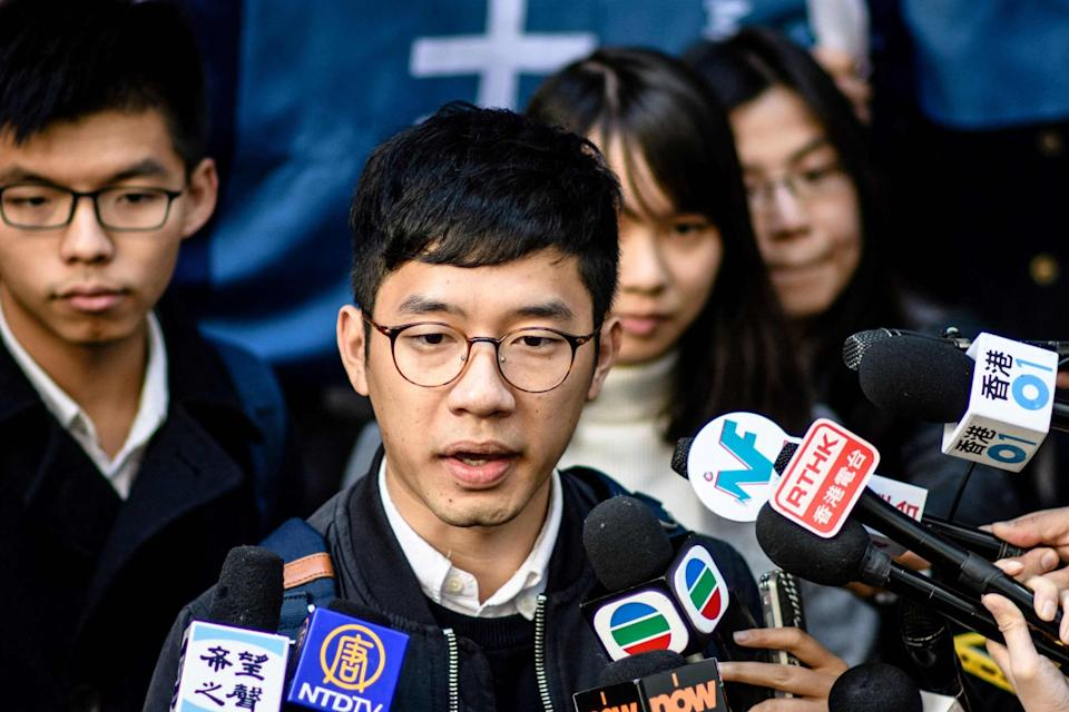 <p>Hong Kong democracy activist Nathan Law (C) speaks to the media outside the Court of Final Appeal </p> (AFP via Getty Images)