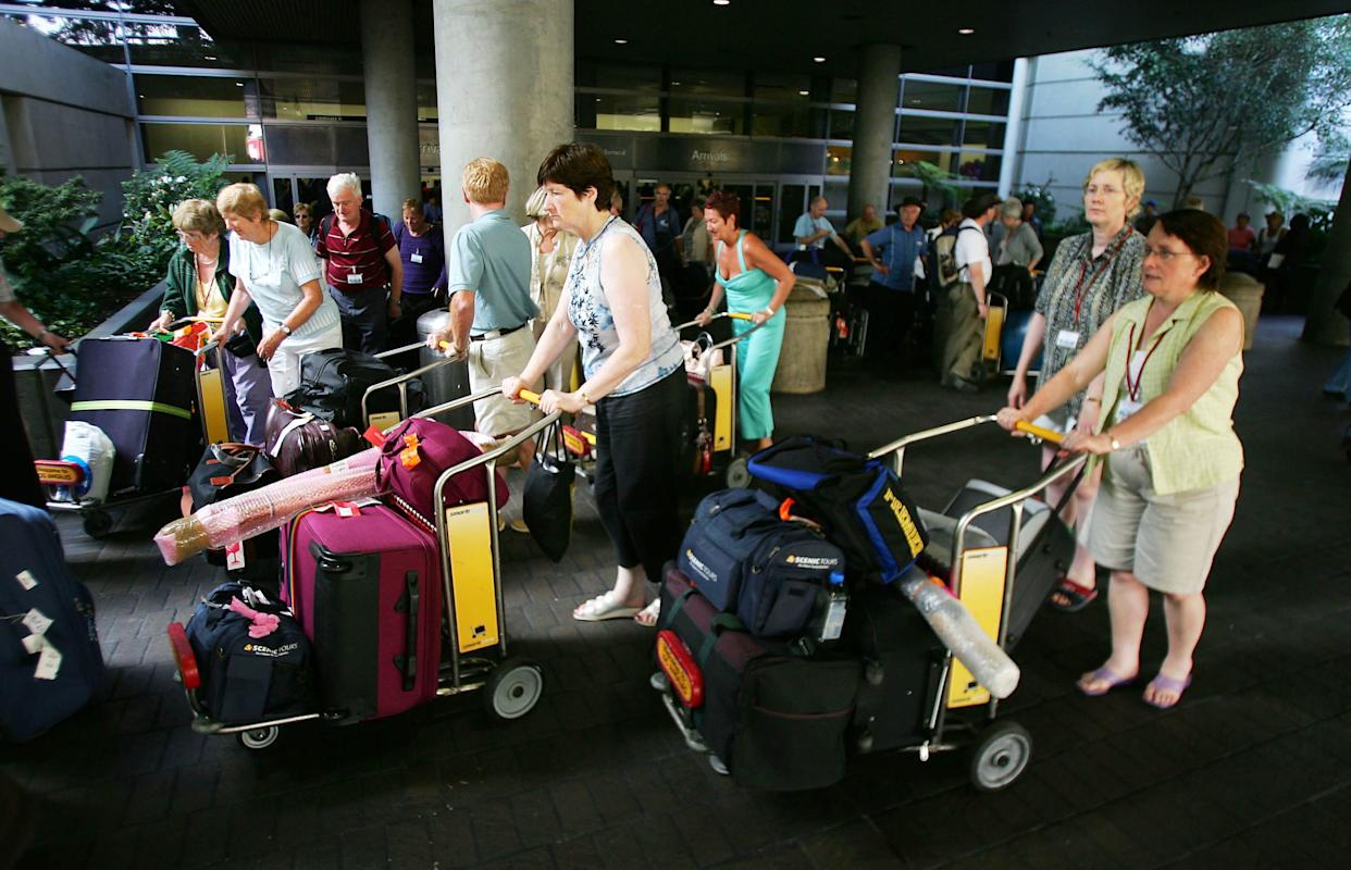 Passengers arrive at Los Angeles International Airport (LAX) Nov. 23, 2004 in Los Angeles, California.