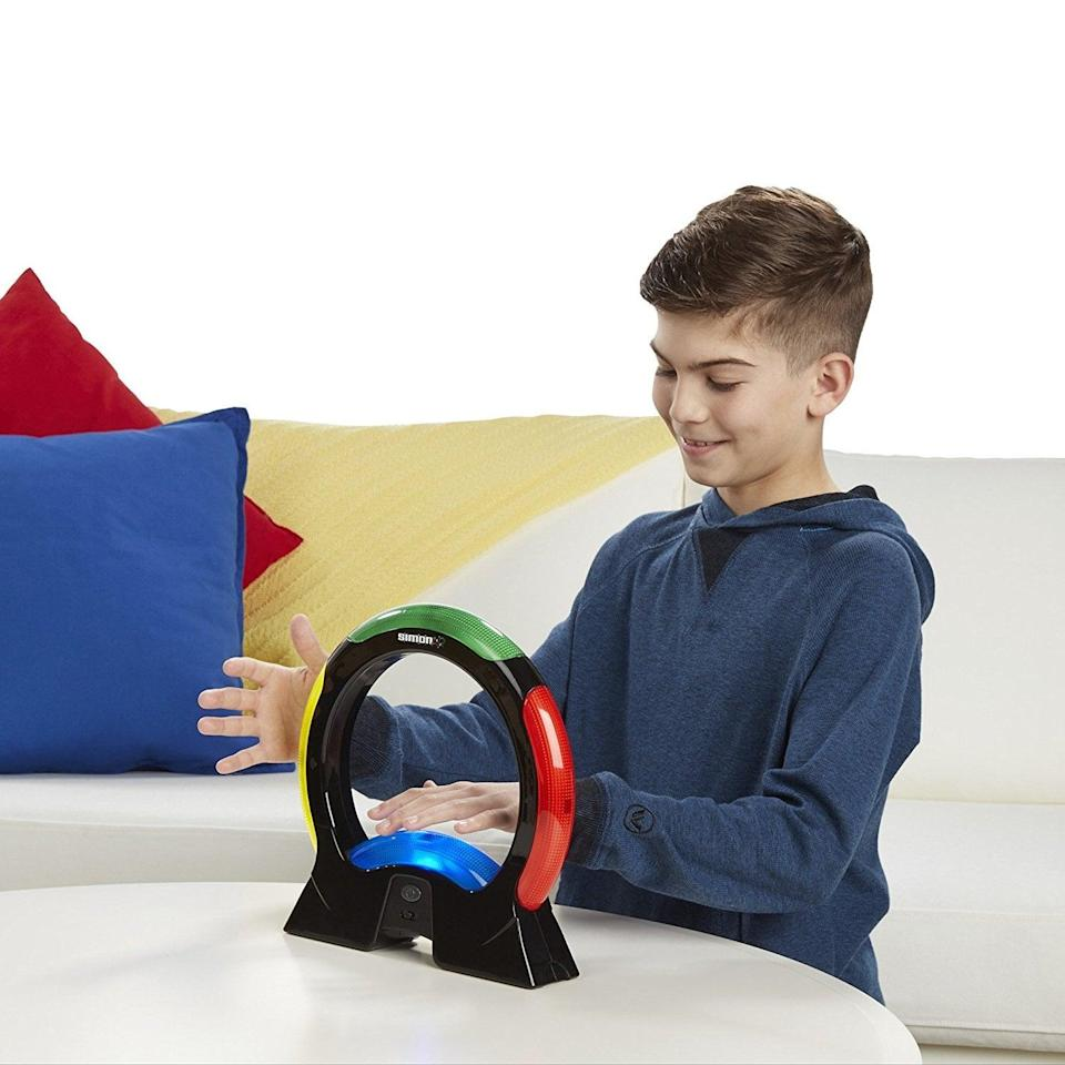 """<p>Parents spent plenty of afternoons playing Simon, and now their kiddos can get in on the fun - in a modern way, of course! <a href=""""https://www.popsugar.com/buy/Simon-Air-330040?p_name=Simon%20Air&retailer=amazon.com&pid=330040&price=20&evar1=moms%3Aus&evar9=25997679&evar98=https%3A%2F%2Fwww.popsugar.com%2Fphoto-gallery%2F25997679%2Fimage%2F42741709%2FSimon-Air-Game&list1=holiday%2Cgift%20guide%2Ckid%20shopping%2Choliday%20living%2Choliday%20for%20kids&prop13=api&pdata=1"""" class=""""link rapid-noclick-resp"""" rel=""""nofollow noopener"""" target=""""_blank"""" data-ylk=""""slk:Simon Air"""">Simon Air</a> ($20) is all the fun of the original with an updated hover motion.</p>"""