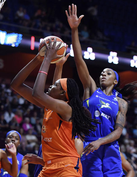 Connecticut Sun center Jonquel Jones drives by Dallas Wings forward Glory Johnson during a WNBA basketball game Wednesday, Sept. 4, 2019, in Uncasville, Conn. (Sean D. Elliot/The Day via AP)