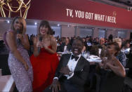 In this video grab issued Sunday, Sept. 19, 2021, by the Television Academy, Susan Kelechi Watson, left, and Mandy Moore, second from left, perform during the opening number of the Primetime Emmy Awards. (Television Academy via AP)