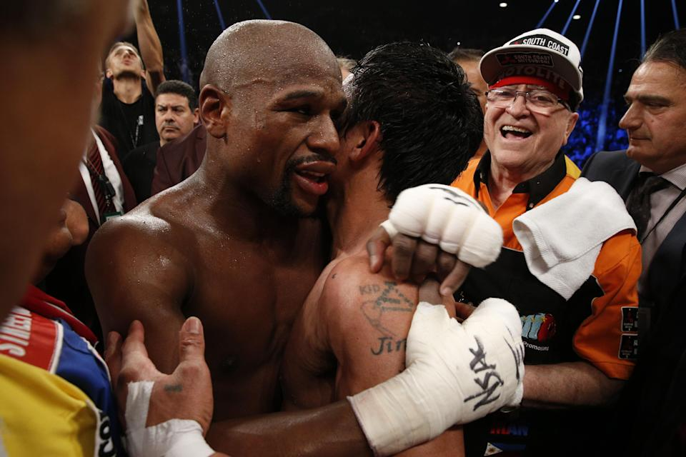 Floyd Mayweather and Manny Pacquiao embrace after their 2015 bout in Las Vegas. (Getty Images)