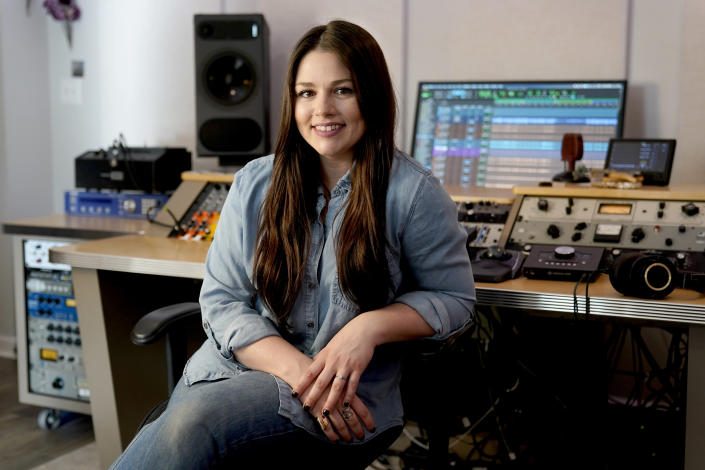 Gena Johnson poses in her home studio in Nashville, Tenn. on April 8, 2021. Johnson, a recording engineer, is the first woman to ever be nominated for engineer of the year by the Academy of Country Music. (AP Photo/Mark Humphrey)