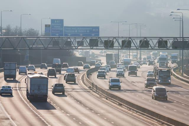 Traffic on the British motorway M25 in a sunset time.