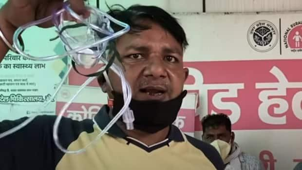 A man in Meerut yells and swears at a a video camera, decrying Modi's political party for failing to secure medical supplies such as oxygen.