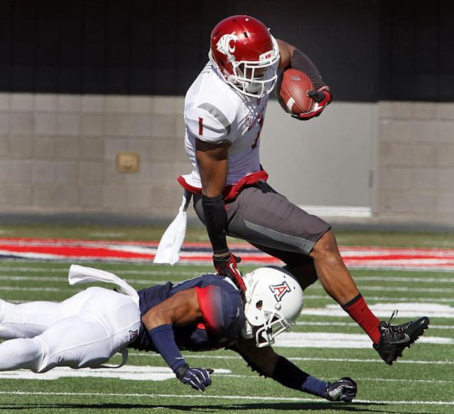 Washington State's Vince Mayle (1) avoids the tackle by Arizona's Shaquille Richardson, left, in the first half of an NCAA college football game on Saturday, Nov. 16, 2013 in Tucson, Ariz. (AP Photo/John MIller)