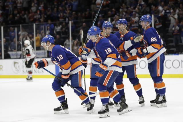 New York Islanders center Josh Bailey, left, celebrates with teammates after scoring during the second period of an NHL hockey game against the Arizona Coyotes on Thursday, Oct. 24, 2019, in Uniondale, N.Y. (AP Photo/Frank Franklin II)