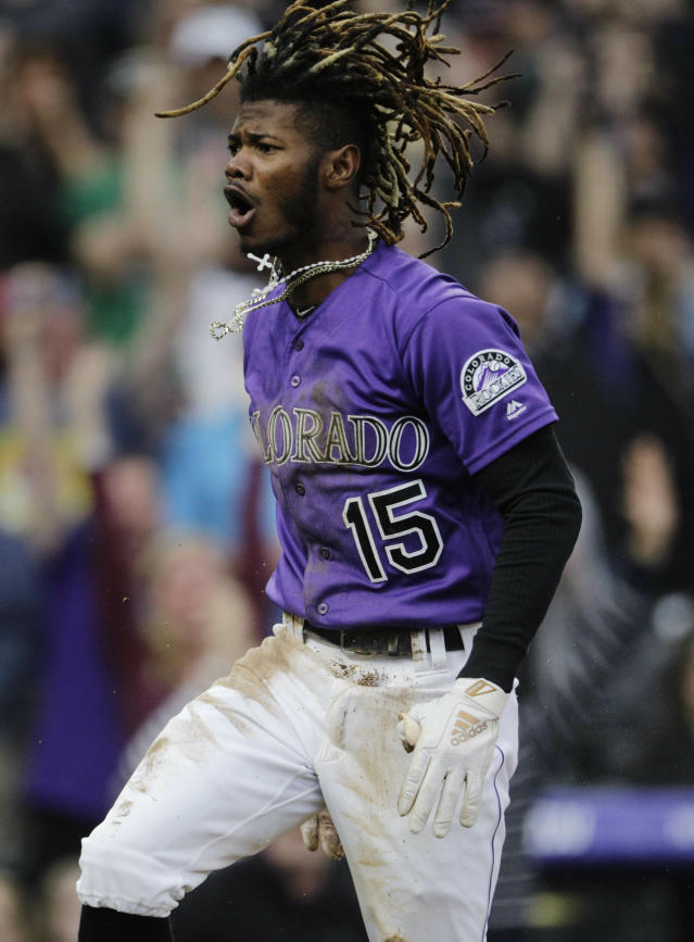 Colorado Rockies center fielder Raimel Tapia reacts after hitting an inside-the-park home run against the Philadelphia Phillies in the first inning of a baseball game in Denver, Saturday, April 20, 2019. (AP Photo/Joe Mahoney)