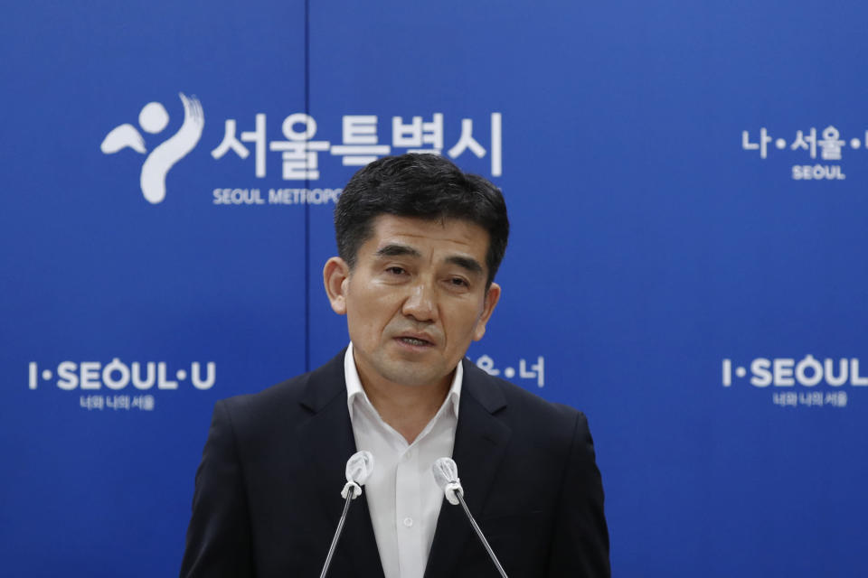 Seoul Metropolitan Government spokesperson Hwang In-sik speaks to the media at Seoul City Hall in Seoul, South Korea, Wednesday, July 15, 2020. The city government of the South Korean capital, Seoul, said Wednesday it will launch an investigation into allegations of sexual misconduct surrounding late Mayor Park Won-soon, who was found dead after one of his secretaries filed a complaint claiming yearslong abuse. (AP Photo/Lee Jin-man)