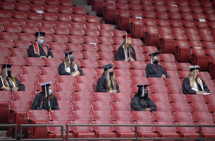 Some students sat in the stands at Coleman Coliseum (Matthew Wood - University of Alabama Photography)