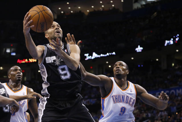 San Antonio Spurs guard Tony Parker (9) shoots in front of Oklahoma City Thunder forward Serge Ibaka (9) and center Kendrick Perkins during the third quarter of an NBA basketball game in Oklahoma City, Thursday, April 3, 2014. Oklahoma City won 106-94. (AP Photo/Sue Ogrocki)