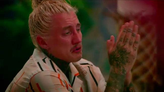 Bachelor In Paradise's Ciarran Stott gets upset during a Bula banquet dinner