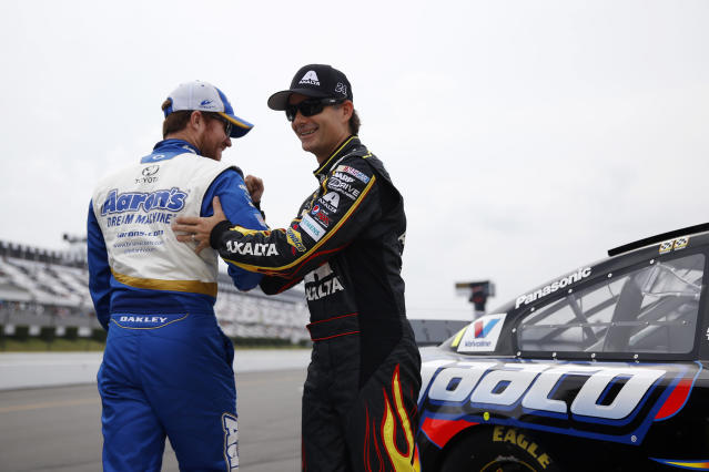 Jeff Gordon, right, and Brian Vickers laugh before qualifying for Sunday's NASCAR Sprint Cup Series auto race at Pocono Raceway, Friday, Aug. 1, 2014, in Long Pond, Pa. (AP Photo/Matt Slocum)