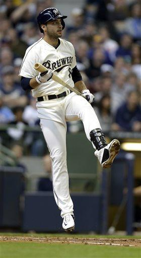 Milwaukee Brewers' Ryan Braun reacts after hitting a pitch foul against the Chicago White Sox during the third inning of an exhibition baseball game Saturday, March 30, 2013, in Milwaukee. (AP Photo/Jeffrey Phelps)