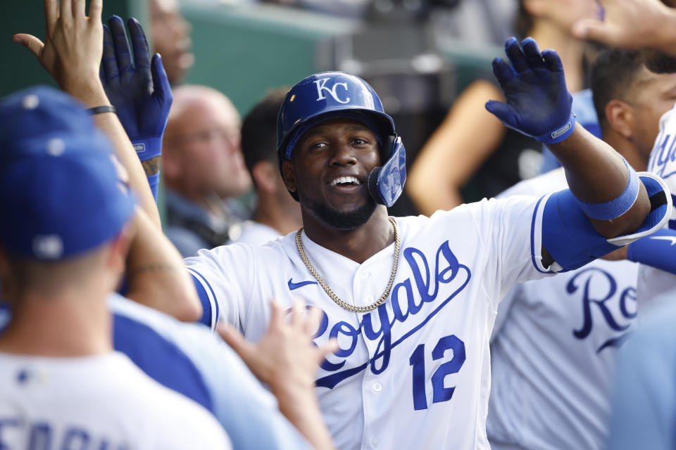 Kansas City Royals' Jorge Soler celebrates in the dugout after hitting a home run during the fourth inning of a baseball game against the Chicago White Sox at Kauffman Stadium in Kansas City, Mo., Monday, July 26, 2021. (AP Photo/Colin E. Braley)
