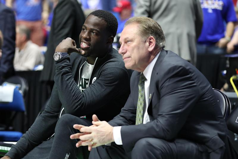 Mar 19, 2017; Tulsa, OK, USA; Golden State Warriors power forward Draymond Green speaks to Michigan State Spartans head coach Tom Izzo before the game between the Kansas Jayhawks and the Michigan State Spartans in the second round of the 2017 NCAA Tournament at BOK Center. Mandatory Credit: Brett Rojo-USA TODAY Sports